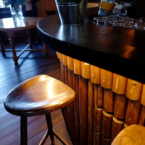 Stool by the bar at one of the most enjoyable features of the Le Coucou Hotel, the Mountain Bar.