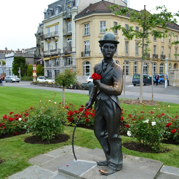 Statue of Charlie Chaplin at the center of a beautiful park at the Caux/Montreux region