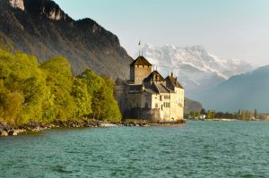 The Castle of Chillon built on the Lake Geneva in Caux Montreux where Le Coucou Hotel is located
