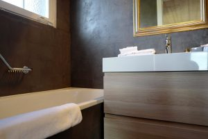 Stylish wash basin and bathtub at the bathroom of the Le Coucou Hotel and Restaurant in Montreux.