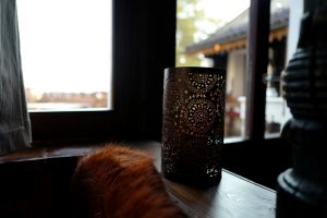 Candle by the window at the Mountain Bar at the Le Coucou Restaurant in Montreux.