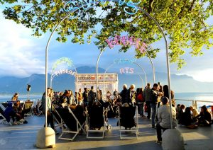 Tourists enjoying themselves during a fest near the Lake Geneva in Montreux.